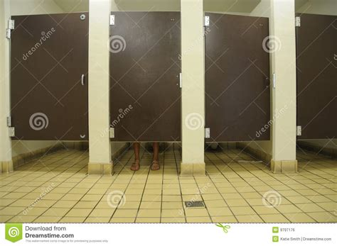 tapping your foot in a bathroom stall bathroom feet royalty free stock image image 9797176