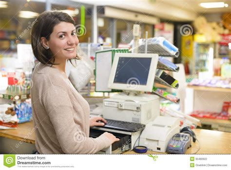 happy cashier stock photo image of discount grocery 35480922