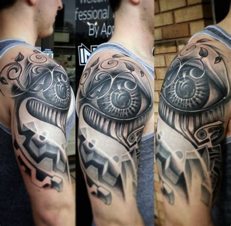 robotic tattoos 50 mechanic tattoos for masculine robotic overhauls