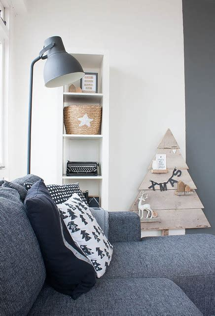 hoang minh nordic style living with windowed walls scandinavian style on a budget in a small city apartment