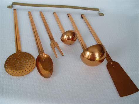 vintage copper kitchen utensils with hanging bar