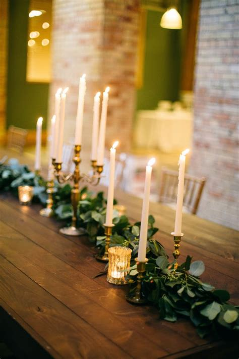 taper candle and greenery centerpiece greenery