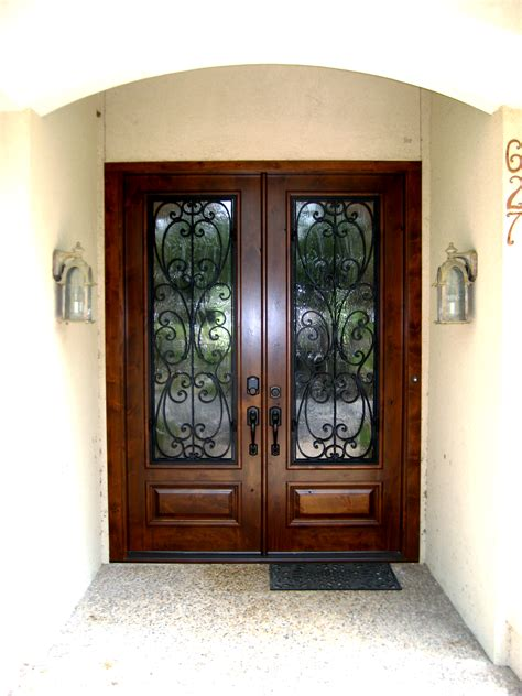 wood and wrought iron grill door this front door