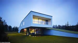 house features futuristic home features a drive thru art gallery daily