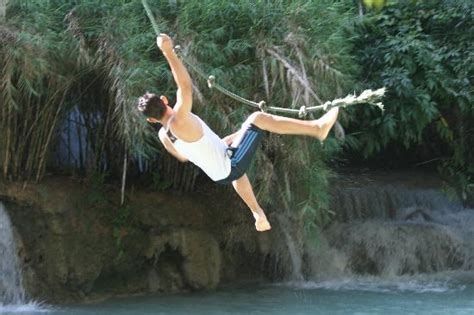 swinging on a rope rope swing picture of kuang si falls luang prabang
