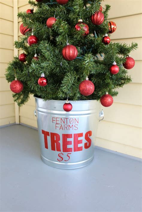 slim christmas tree in galvanized bucket diy galvanized tree tub 2 bees in a pod