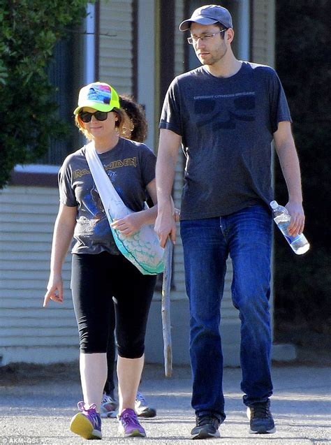 nick kroll house amy poehler wears a smile as she steps out with a mystery
