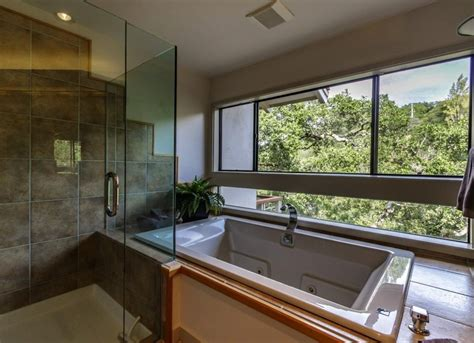 9 home design trends to ditch in 2016 tub and bathroom with a view interior design