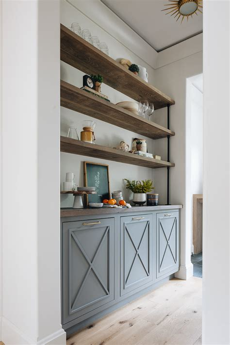 painted  cabinets  floating wood shelves
