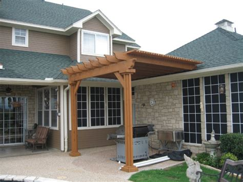 pergola attached to roof attached above roof line for the yard