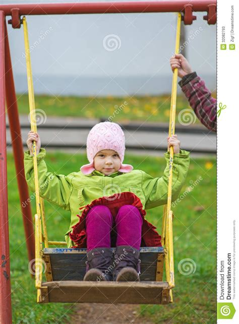 mom swings baby around stock photos mom rolls daughter on swing image 32082793