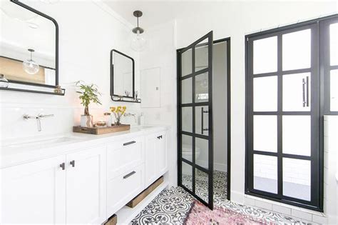pink rug on black and white cement tile bathroom floor