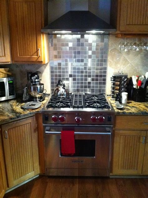 stainless steel backsplash range my new wolf range with 2x2 inch stainless steel tile