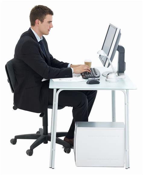 Man Sitting At A Desk Person At Desk Hostgarcia