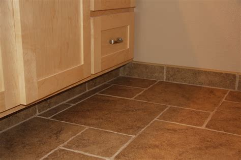 tile or wood baseboard in bathroom nutmeg co inside