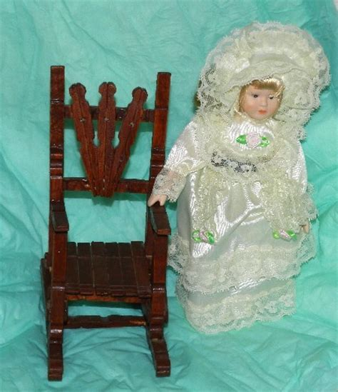 porcelain doll on rocking beautiful porcelain 8 doll and wooden rocking chair figures