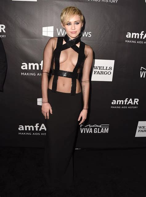 Studded Floor Mirror by Miley Cyrus Barely Covers In Risky Black Dress At