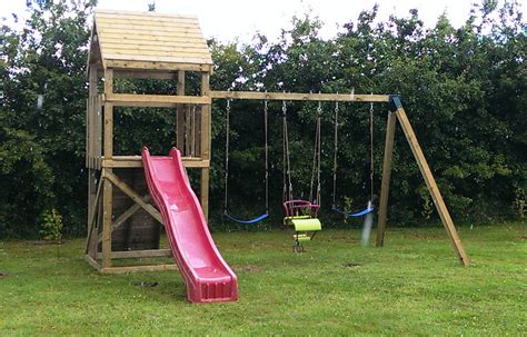 swings and climbing frames climbing frame triple swing set whitethorn garden buildings