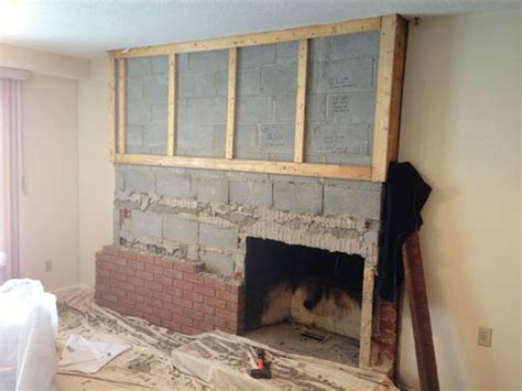 fireplace remodel replacing brick facing concrete