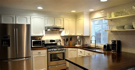 spray painting kitchen cabinets before and after suburbs painting our kitchen cabinets