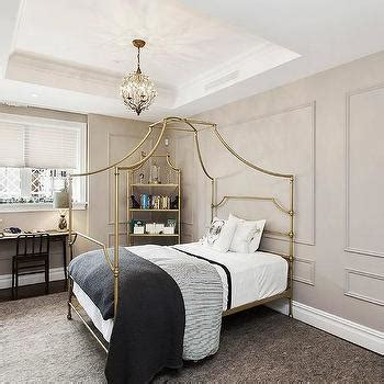 gold canopy bed teen girl bedroom with hanging rattan chair and white