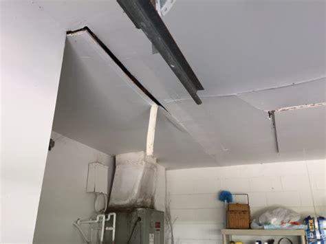 X Pole Ceiling Damage by Gallery Drywall Repair Orlando