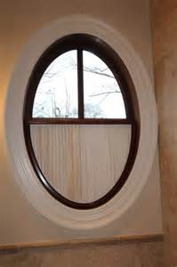 Oval Window Curtain Ideas Oval Window With Pleated Shade Traditional Nashville