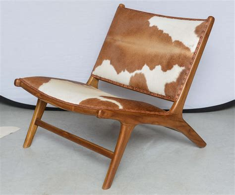 cowhide lounge chair cowhide upholstered teak lounge chair at 1stdibs