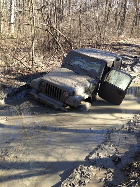 muddy jeep wrangler blue jeep wrangler stuck in mud muddin pinterest