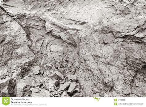 Clay Mud cliff erosion mud clay cracks in rock