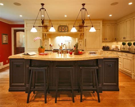 kitchen island bar ideas a true eat in island bar painted distressed black cabinets with a jerusalem gold granite top