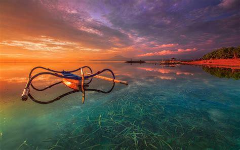 bali indonesia orange sunset khanprosire water sea grass