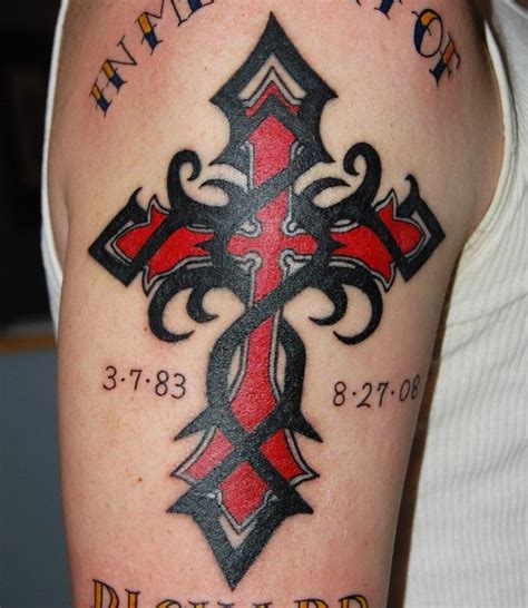 black flames cross tattoo on half sleeve