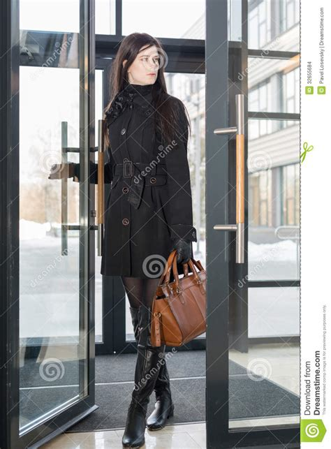 Jaket Catton Door enters pin number in winter royalty free stock photo