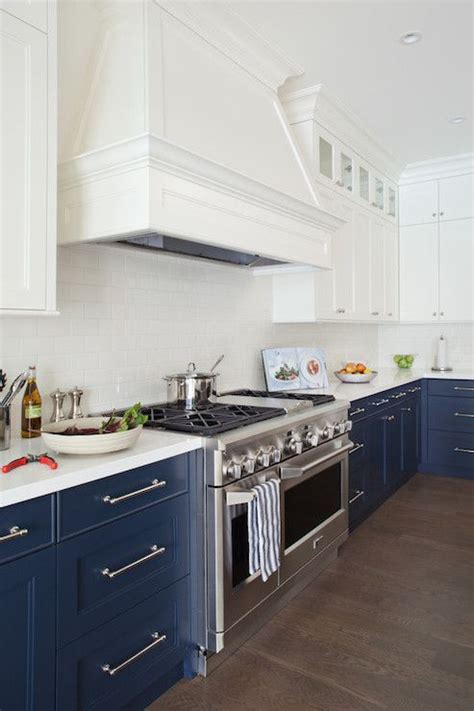 white and navy kitchen with white cabinets and navy