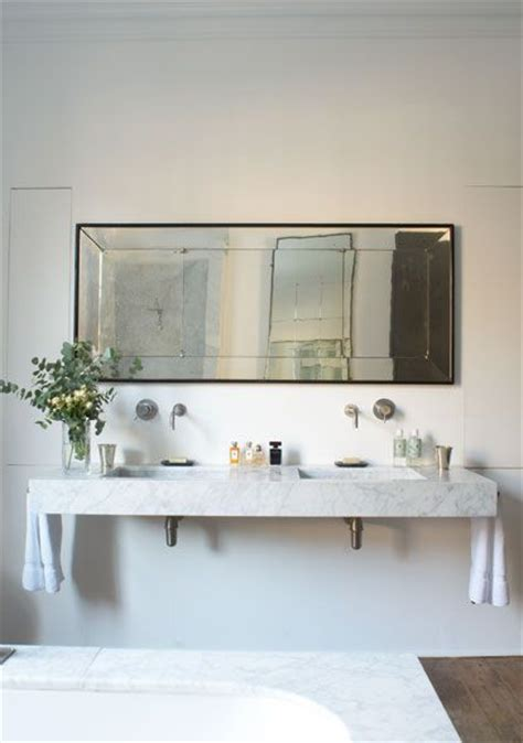 eclectic vintage rectangular mirror floating marble