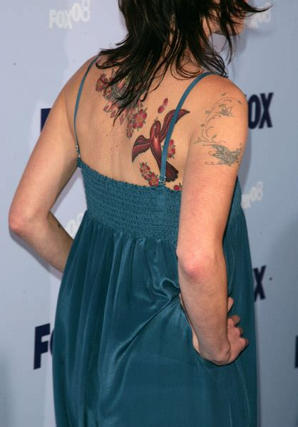 lena headey tattoo lena headey s bird and flower back tattoos photo