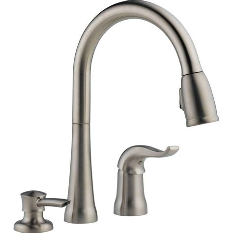 delta kate single handle pull kitchen faucet with soap dispenser the home depot canada