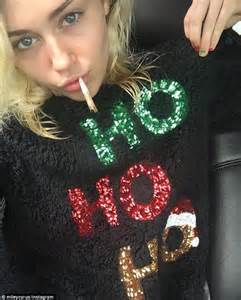 Ho ho ho hours earlier miley tried on another festive sweater this