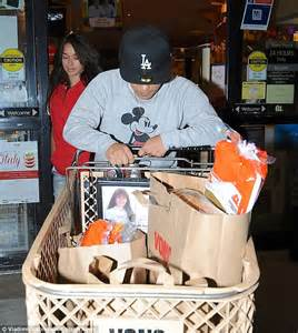 bruno mars struggles to push shopping trolley almost the