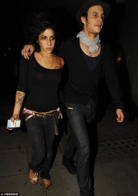 Bloodied And Bruised Winehouse Stands By Husband Who Saved by Winehouse Dead Before And After The Rise And Fall Of