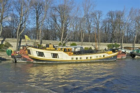 house boat paris paris france river water ship boat house boat