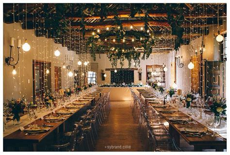 Fairy lights greenery from roof   A&J Wedding Decor and