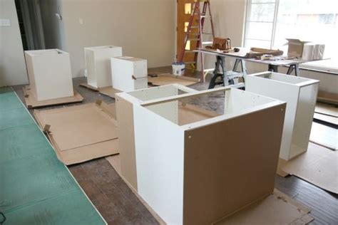 how to level kitchen base cabinets installing our ikea kitchen by house tweaking bob vila