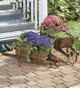 Decorative Wooden Wheelbarrow Planter by Decorative Solid Wood Wheelbarrow Planters These