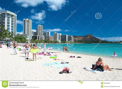 hawaii s finest in stock cabinets honolulu hi tourist sunbathing and surfing on the waikiki beach in