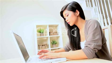 asian at home with laptop royalty free and