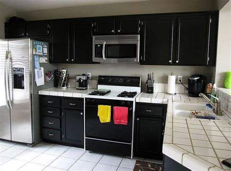 small kitchen with black cabinets white ceramic countertop and corner black cabinet for