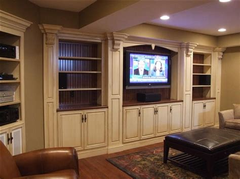 built in media cabinet with glazed cream color cabinets