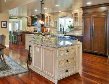 white kitchen cabinets with gothic arch glass front doors arched window over sink flanked by glass front cabinets
